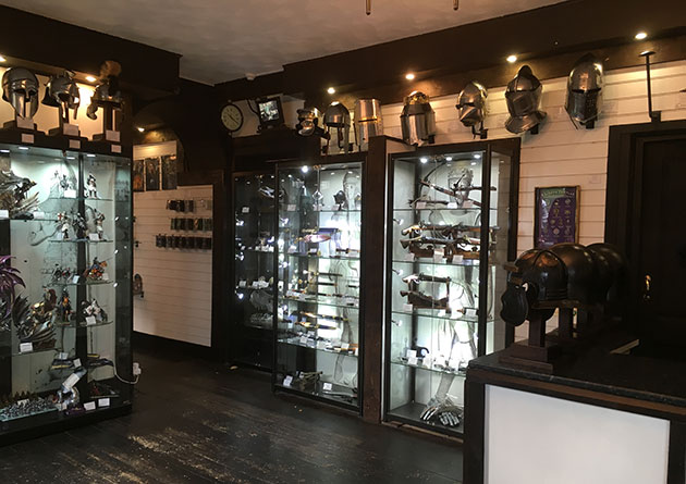 Crossbows, figurines and helmets at the Knight Shop